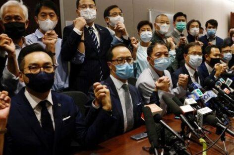 Hong Kong pro-democracy lawmakers resign after China ruling